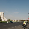 Emilie cycling past Azadi Gate