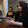 Leominster artist Sahar Ghavimi talks about her art work at her home on Thursday, December 27, 2018. Her husband Hamed Zarei listens to her as she tells her story. SENTINEL & ENTERPRISE/JOHN LOVE