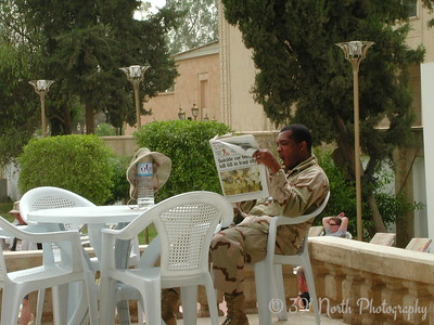 Soldier relaxing by the pool  behind the Republican Palace.