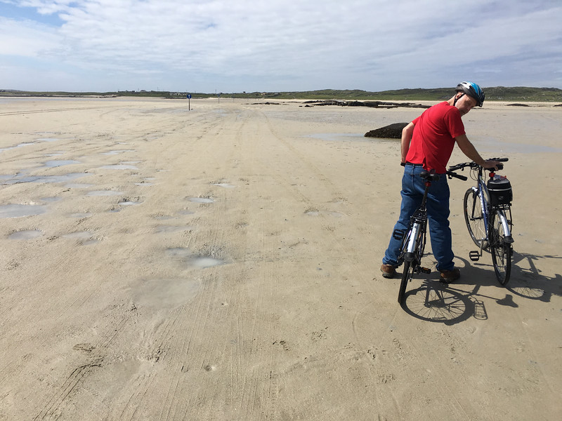 Biking to island when the tide is out.