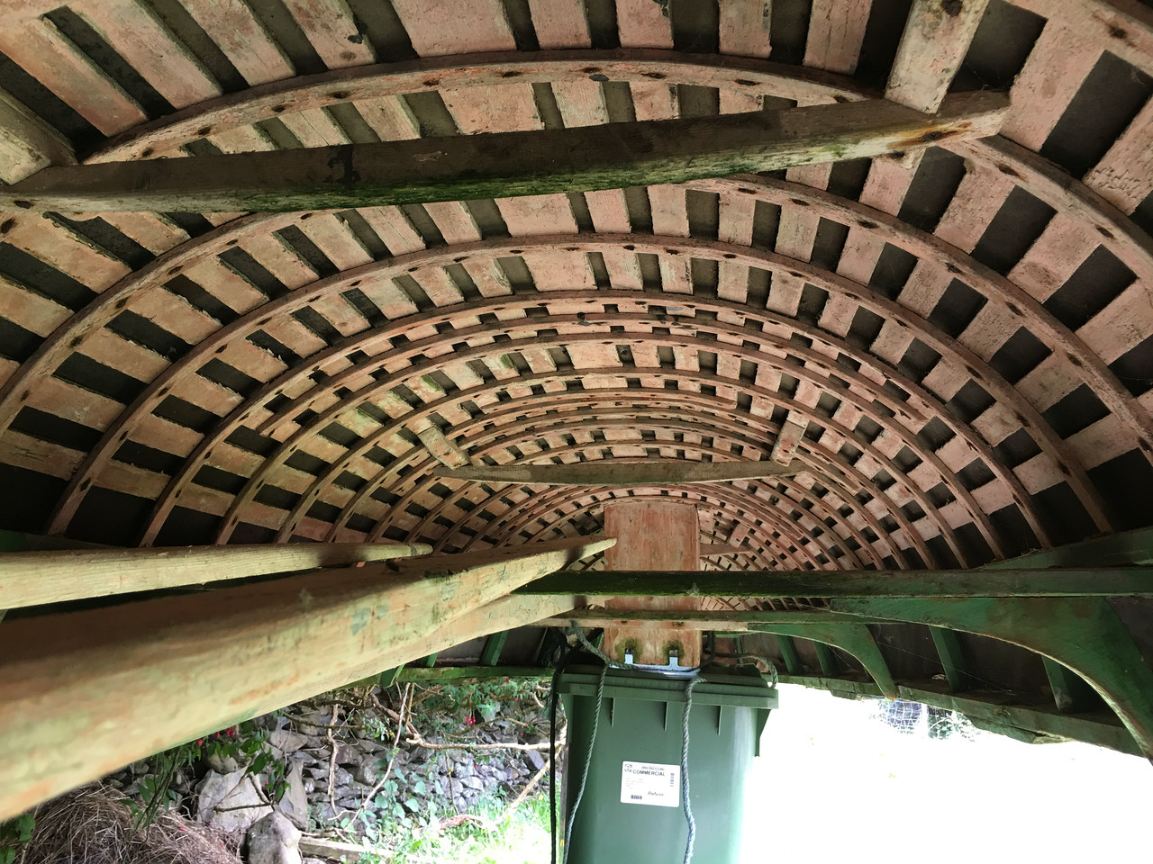 Under the up-side-down boat shows the wood framing
