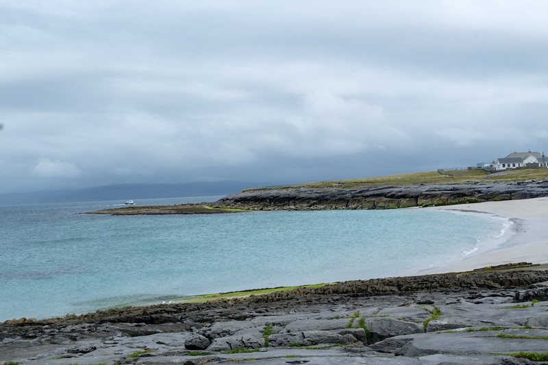 The beach at Inisheer.  You can just make out a ferry in the distance.