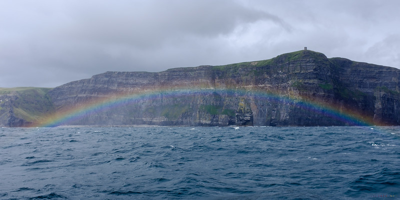 Luck and timing.   <br /> <br /> Lauren all but forgot her sea sickness when we  saw this.  <br /> <br /> A full rainbow over Branaunmore Rock and under the Cliff's of  Moher and O'Briens's Tower . <br /> <br /> It was such a rare occurrence that the crew rushed out to take photos.
