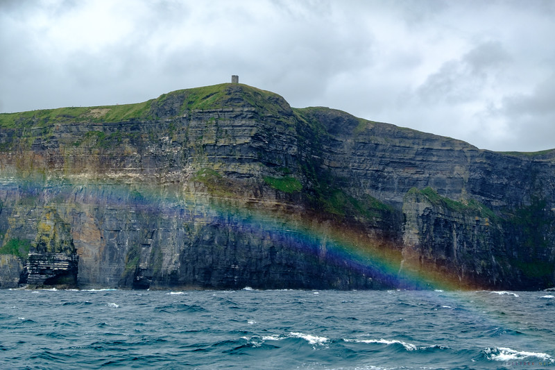 Another view of  the rainbow over Branaunmore Rock and under the Cliff's of  Moher and O'Briens's Tower .