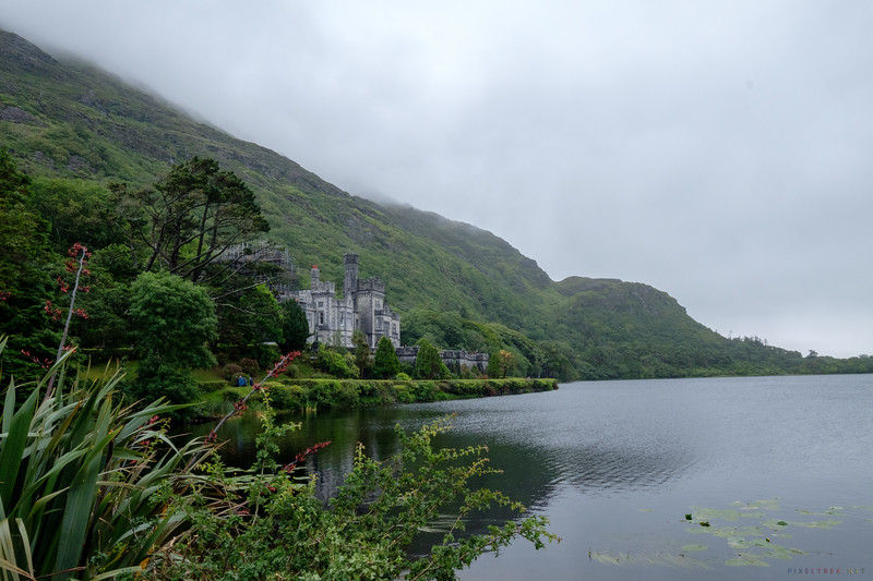 When we arived at Kylemore Abbey, we decided to get a bite to eat in the restaurant which is located at the entrance of the park.  The place was bustling with other tourists.  It seemed to me as if it were more crowded than any other place we'd been in Ireland.  I think that it had more to do with us arriving just before lunch when all the buses had disgorged their passengers and everyone else had the same idea about food.<br /> <br /> We enjoyed a light lunch (and Cindy found a pseudo Dr. Pepper)  and then headed to the gates of the grounds.  We already had our tickets so we walked right in and headed to the Abbey.<br /> <br /> The building is stunning.  Unfortunately they were doing some serious renovations and had scaffolding all over one side of the structure.  I tried to get at an angle for my photo to minimize the refurbishing work but was largely unsuccessful.