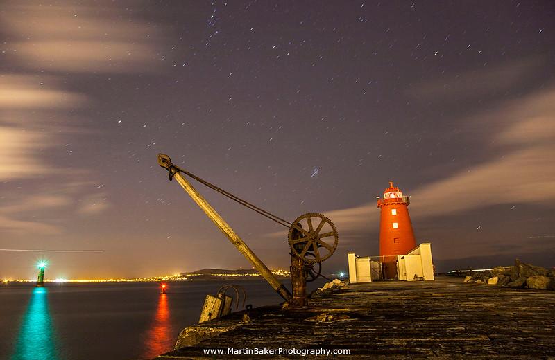 Poolbeg Lighthouse and Howth, South Bull Wall, Dublin Bay, Dublin, Ireland.
