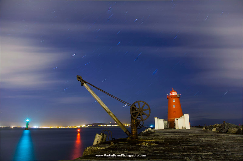 Poolbeg Lighthouse and Howth, South Bull Wall, Dublin Bay, Dublin, Ireland.