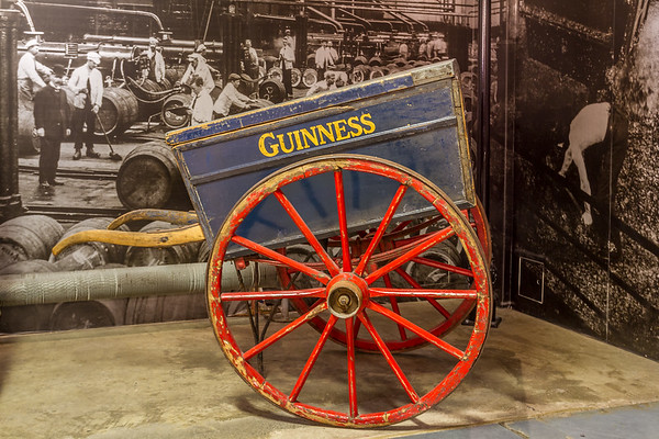 Guinness Brewery - Old wagon in front of historical photo of Guinness Brewery - Dublin Ireland - close