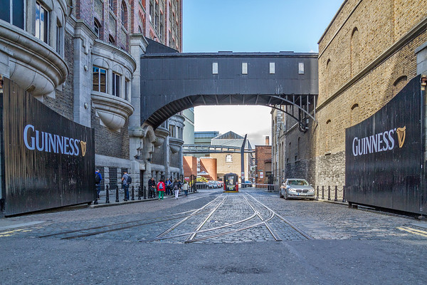 Entrance to Guinness Storehouse with old railroad tracks in the road - Dublin Ireland