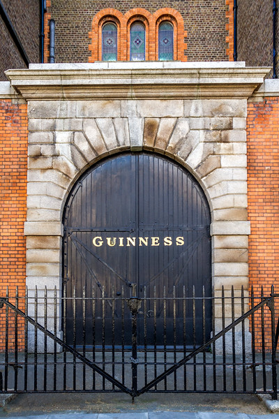 Round arched double black  door with wrought iron fence in front - Guinness - Dublin Ireland