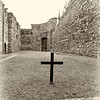 Kilmainham Gaol from inside the executioners courtyard looking from cross to exterior door - Dublin Ireland - Sepia