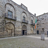 Kilmainham Gaol Museum courtyard from inside fence corner with sign and flag - Dublin Ireland