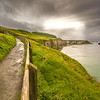View of the path by Carrick-A-Rede Rope Bridge at the Causeway Coastline - Ballintoy, County Antrim Northern Ireland