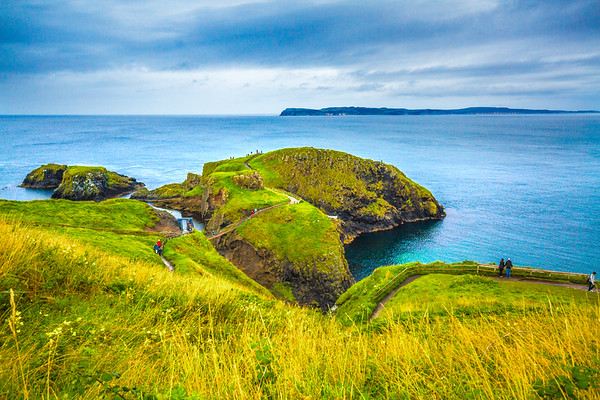 View of the Carrick-A-Rede Rope Bridge connecting islands off the Causeway Coastline from higher up - Ballintoy, County Antrim Northern Ireland
