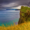 View of cliffs and storm clouds off the Causeway Coastline - Ballintoy, County Antrim Northern Ireland - closer