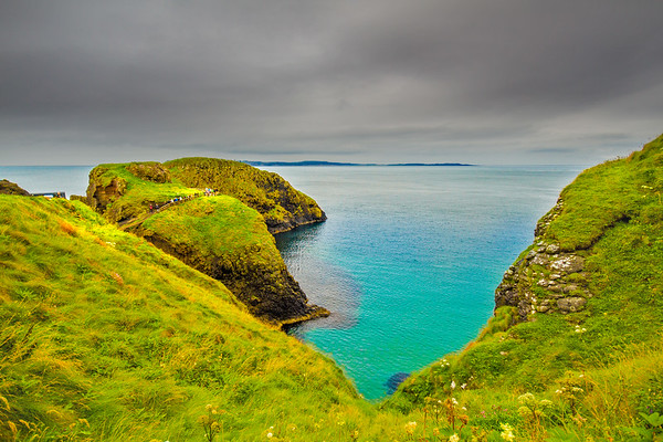 View of the Carrick-A-Rede Rope Bridge and connecting islands off the Causeway Coastline - Ballintoy, County Antrim Northern Ireland