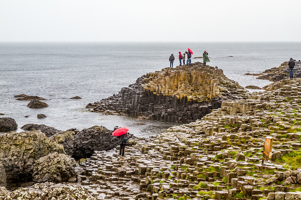 People in the rain at The Giant's Causeway - County Antrim Northern Ireland