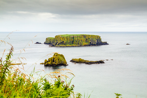 View of the island off the Causeway Coastline from the Carrick-A-Rede Rope Bridge - Ballintoy, County Antrim Northern Ireland