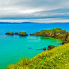 View of the Carrick-A-Rede Rope Bridge connecting islands off the Causeway Coastline - Ballintoy, County Antrim Northern Ireland - Panorama - better