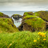 View of the Carrick-A-Rede Rope Bridge off the Causeway Coastline - Ballintoy, County Antrim Northern Ireland