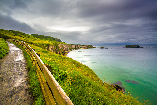 View of the path, cliffs and sea by Carrick-A-Rede Rope Bridge at the Causeway Coastline - Ballintoy, County Antrim Northern Ireland