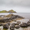People on the basalt rock formations at the edge of the Causeway Sea - County Antrim