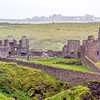 Dunluce Castle courtyard with person inside for scale in County Antrim - Northern Ireland - 2