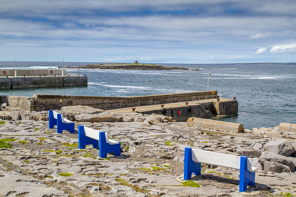 Doolin Harbour with blue and white benches on the rocks overlooking the Atlantic County Clare - Ireland