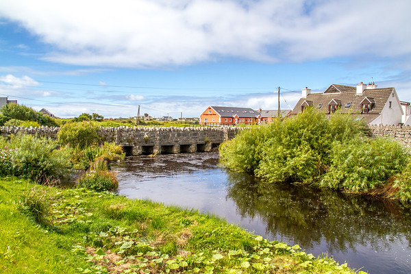 Stone bridge over Aille River flowing under in Doolin County Clare - Ireland