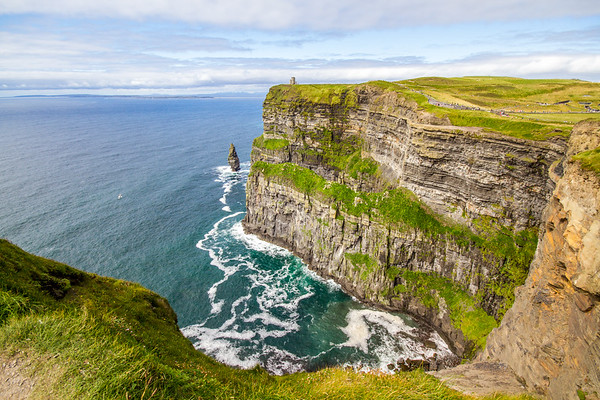 Cliffs of Moher looking out to O'Briens Tower and Branaunmore sea stack in County Clare - Ireland