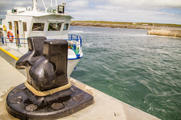 Boat tied to bollard in Doolin Harbour County Clare - Ireland