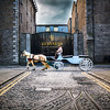 Guinness brewery - St James gate Dublin - horse and carriage - white jacket - right to left - with vignette