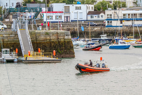 Rubber dinghy moving in the bay at St Michaels Rowing Club in Dun Laoghaire County - Dublin Ireland