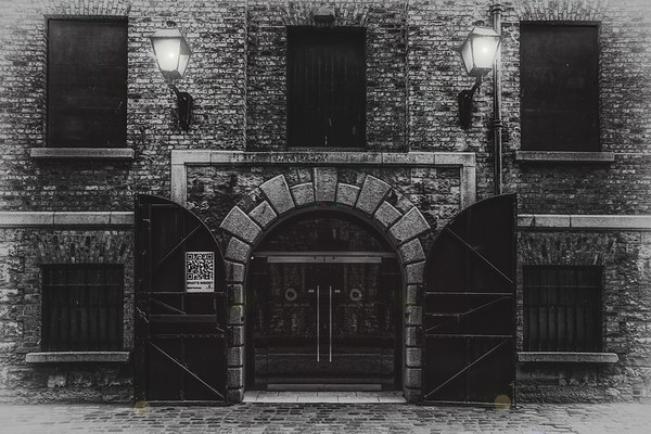 The Digital Hub - Doors and windows in old stone and brick wall on Sugar House Lane near Guinness Brewery - Dublin Ireland - BW 2