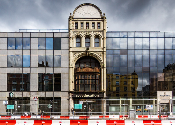 Building with reflections of buildings in glass - Westmoreland St Dublin