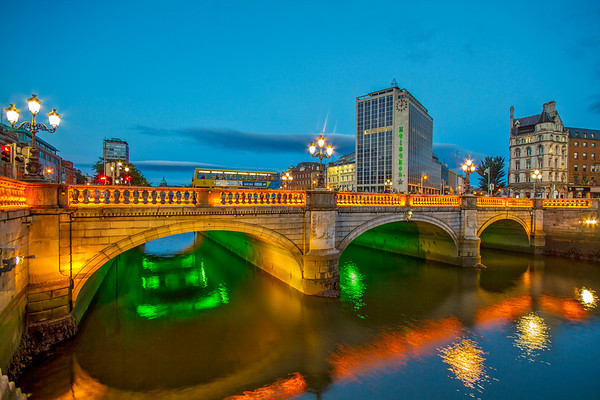 Heineken Building and O'Connel bridge at blue hour with bus going across - Dublin Ireland