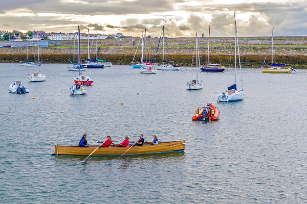 Rowing a boat in the bay at St Michaels Rowing Club  in Dun Laoghaire County - Dublin Ireland