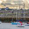 Sail Boats in the bay at St Michaels Rowing Club in Dun Laoghaire County towards sunset - Dublin Ireland