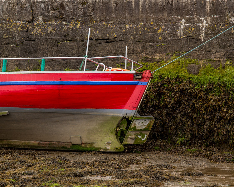 Red and grey boat with blue stripe in Kinvara Harbour low tide - 2