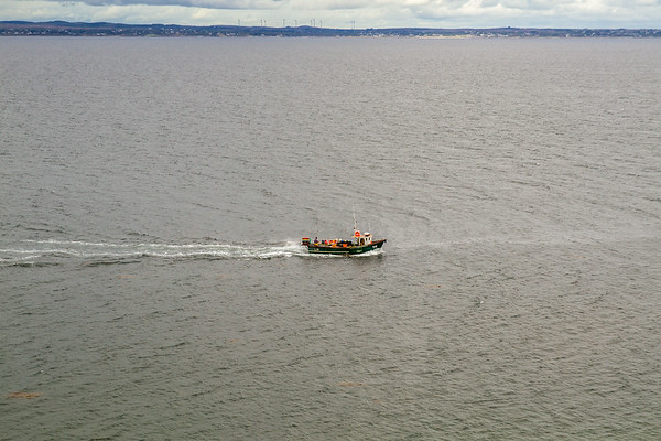 Fishing boat heading out of Galway Bay - Ireland