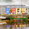 Kinvara Harbour - Fairy Queen and man filling fuel in dinghy low tide - Ireland