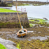 Irish Hooker Boat at low tide in Kinvarra Harbour - County Galway, Ireland