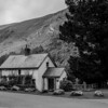 House in Glendalough against mountan backdrop - BW