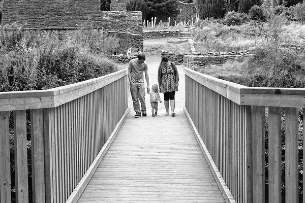 Family walking on bridge from Monastic Settlement in Glendalough