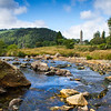 Glendalough stream and ancient tower