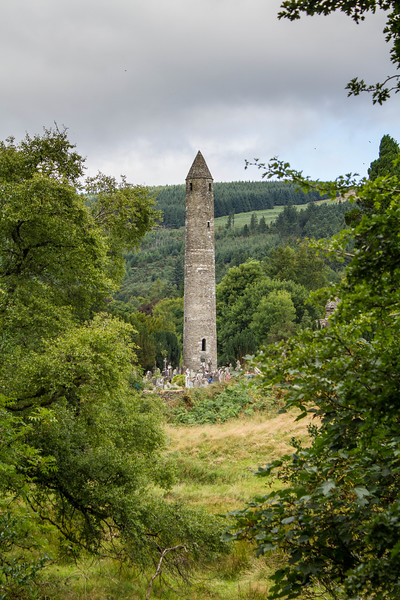 Glendalough Ancient Tower framed by trees