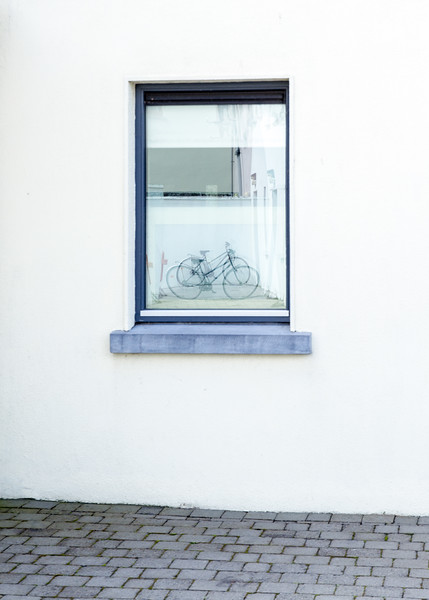 Bicycle reflection in a window in Doolin - Ireland