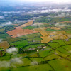 Flight into Ireland - clouds over fields