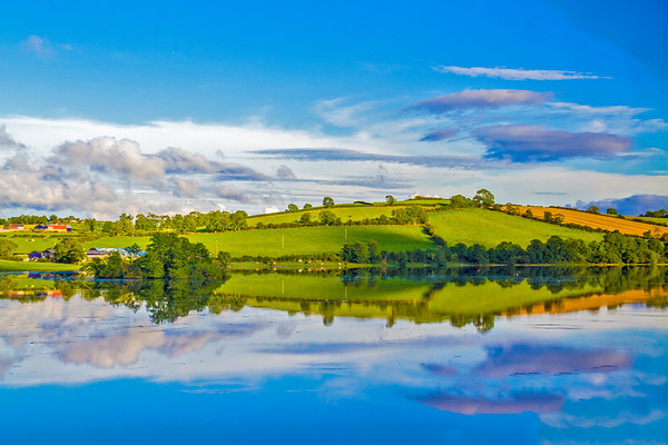 Irish hill and fields with cows  and reflection in lake - Northern Ireland - 2