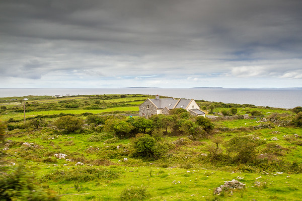 House in Irish fields - by the sea - Ireland